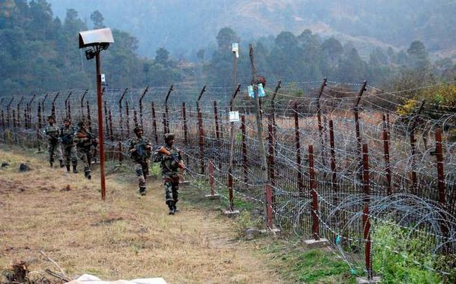 Indian soldiers stand guard near the Line of Control in Poonch, Jammu and Kashmir state. File photo: The Hindu