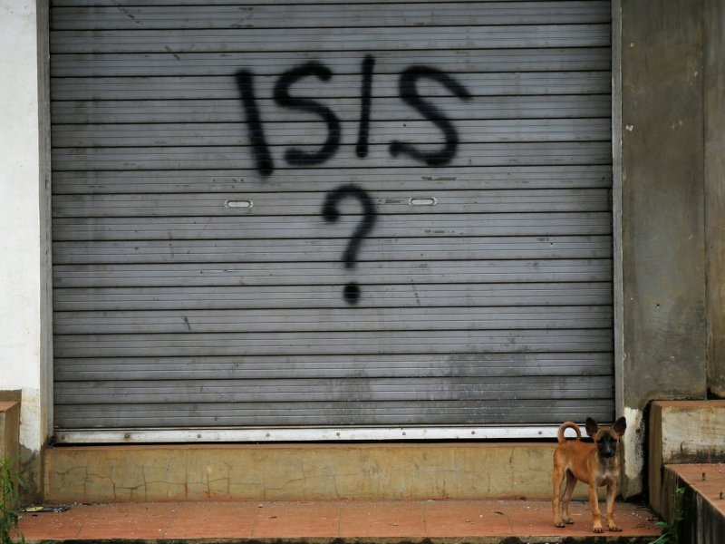 Graffiti is seen on the shutters of a closed shop as government troops continue their assault against Islamic State-backed insurgents from the Maute group in Marawi city, Philippines, on June 29, 2017. Photo: Reuters / Jorge Silva