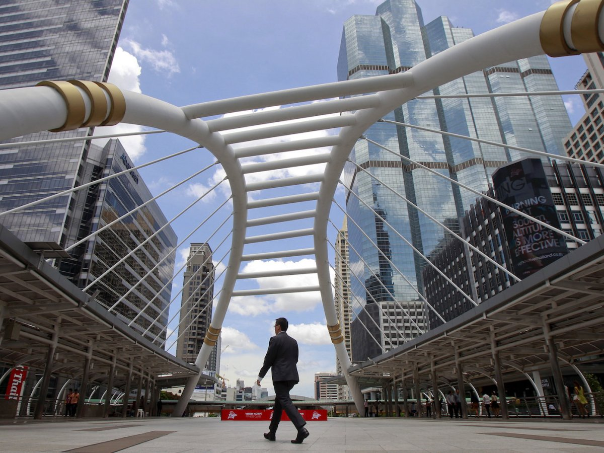 A man walks in Bangkok's central business area in a May 22, 2015 file photo.  Photo: Reuters/Chaiwat Subprasom