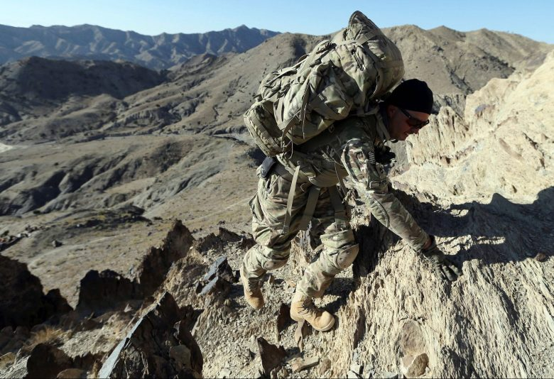 A US soldier climbs a hill with a heavy rucksack near the town of Walli Was in Paktika province, near the border with Pakistan, in a file photo. Photo: Reuters/Goran Tomasevic/File Photo