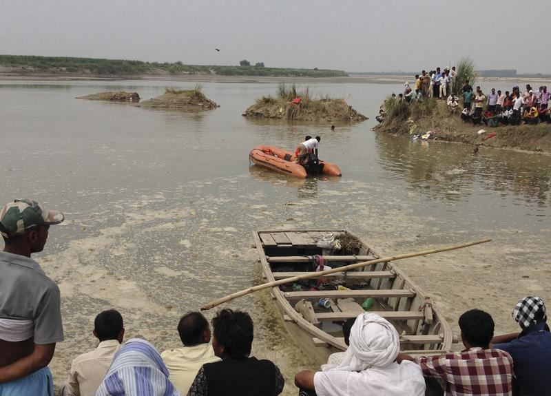 Rescuers search the Yamuna River near Baghpat town in Uttar Pradesh state after a boat carrying dozens of people capsized on Thursday. Photo: The National