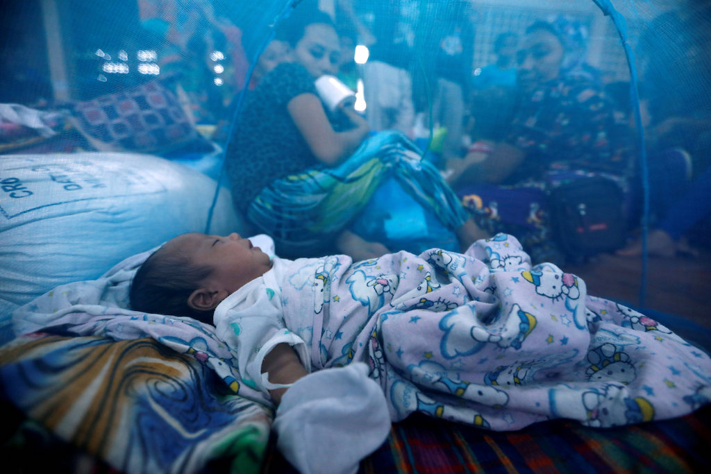 A file shot of a baby under a mosquito net in the southern Philippines.  Scientists in Bangkok have warned that resistance to key anti-malaria drugs has spread across mainland Southeast Asia. Photo: Reuters/ Jorge Silva