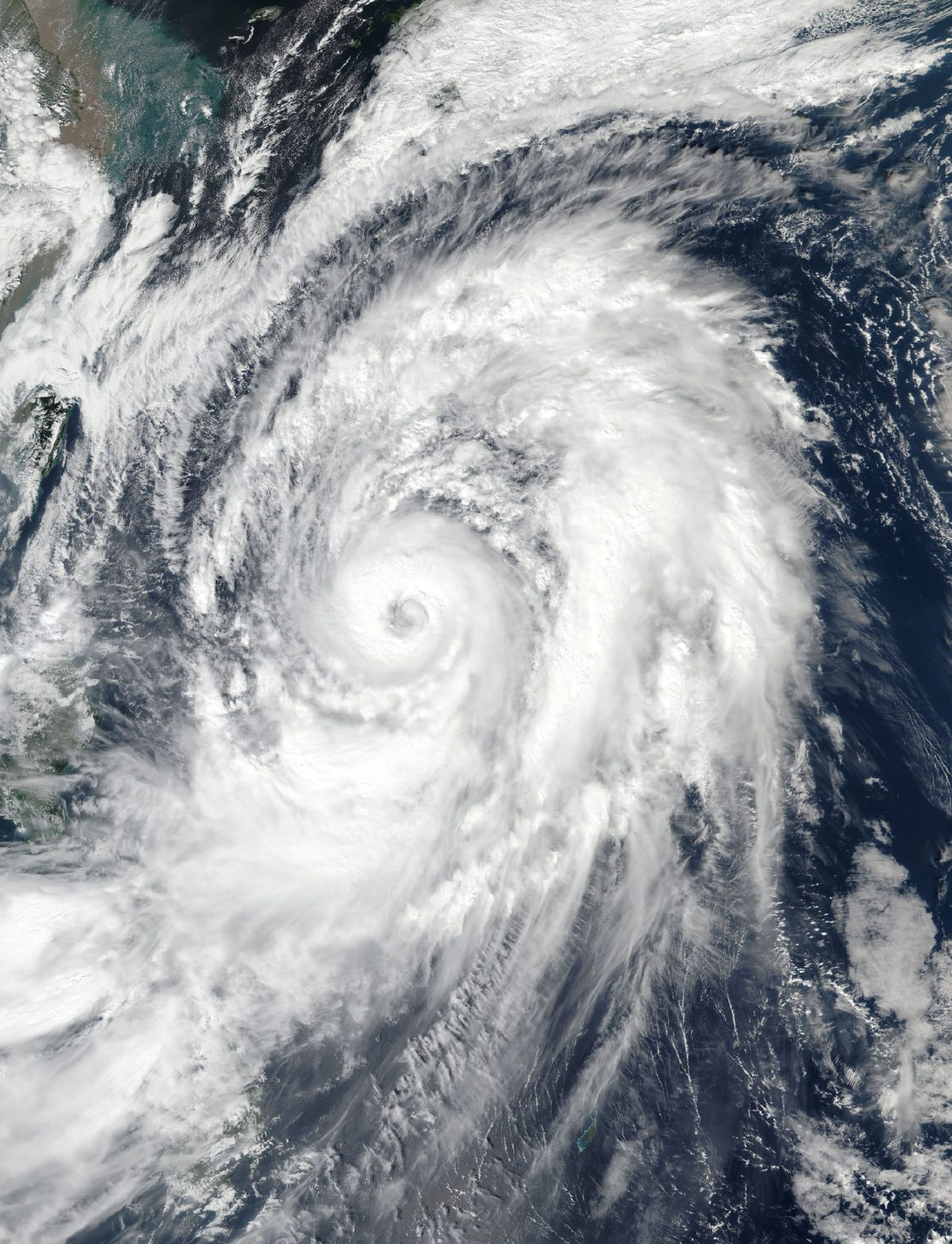 This NASA Earth Observatory image obtained on October 21, 2017, shows a natural-color image of Typhoon Lan in the western Pacific on October 20, 2017. Photo: AFP / NASA Earth Observatory / Handout.