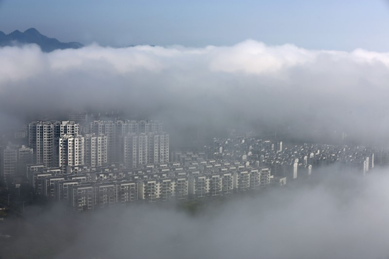 Residential buildings are seen after rain in Huangshan, Anhui province, China May 12, 2016. Photo: Reuters/Stringer
