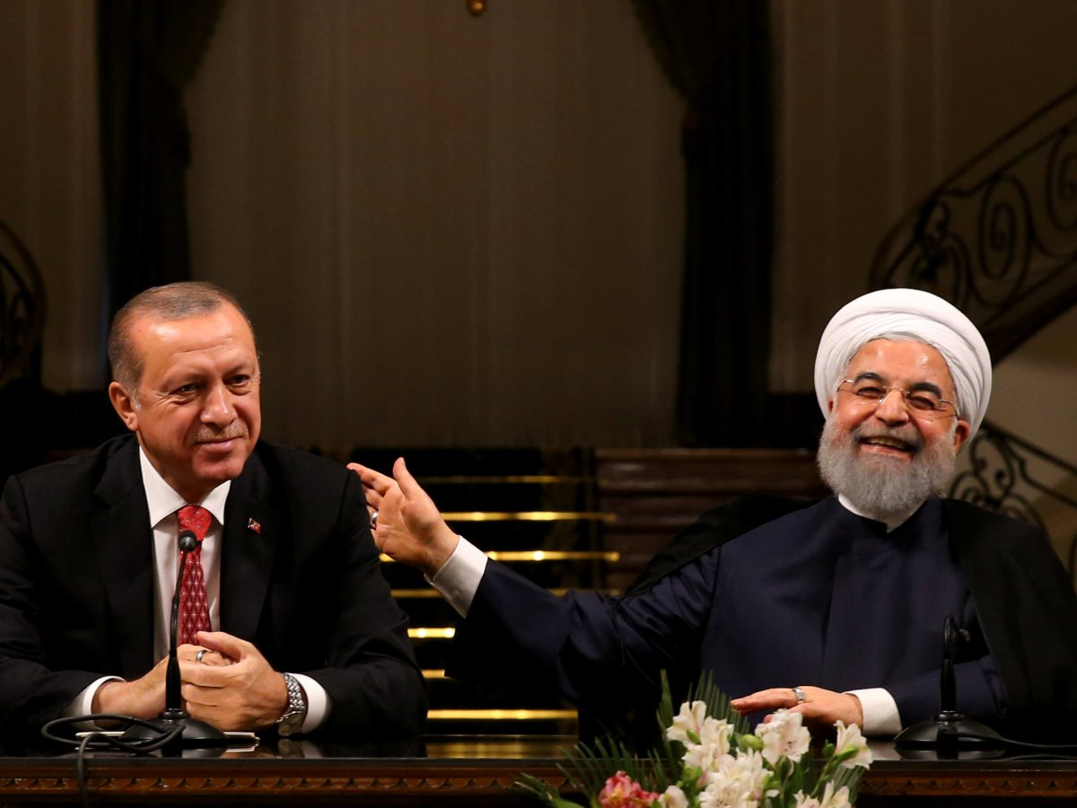 Turkish President Tayyip Erdogan is seen with his Iranian counterpart Hassan Rouhani during a joint news conference in Tehran, Iran, on October 4, 2017. Photo: Murat Cetinmuhurdar / Presidential Palace/ Handout via Reuters