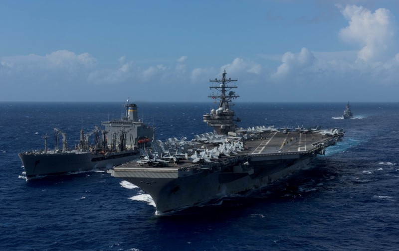 The aircraft carrier USS Ronald Reagan during a replenishment-at-sea with the USNS John Ericsson in waters around Okinawa, October 9, 2017. U.S. Navy/Mass Communication Specialist 2nd Class Kenneth Abbate/via Reuters