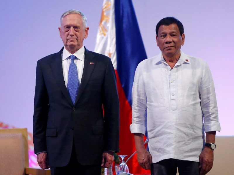 Philippine President Rodrigo Duterte stands with US Defence Secretary James Mattis. Photo: Reuters / Dondi Tawatao