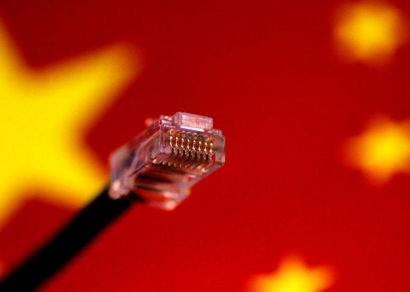 A computer network cable above a Chinese flag in this July 12, 2017 illustration. Photo: Reuters/Thomas White/Illustration