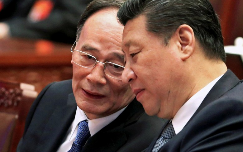 Anticorruption tzar Wang Qishan (L) speaks with Xi Jinping.