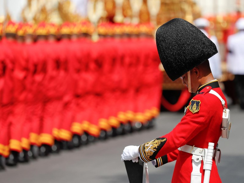A royal guard bows as the Royal Urn of late King Bhumibol Adulyadej is taken on the Great Victory Chariot during the royal cremation procession at the Grand Palace in Bangkok on October 26.  Photo: Reuters / Damir Sagolj