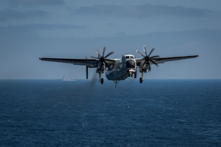 A US Navy C-2A Greyhound prepares to land on the flight deck aboard the aircraft carrier USS Theodore Roosevelt in the Pacific Ocean. Photo: US Navy via AFP