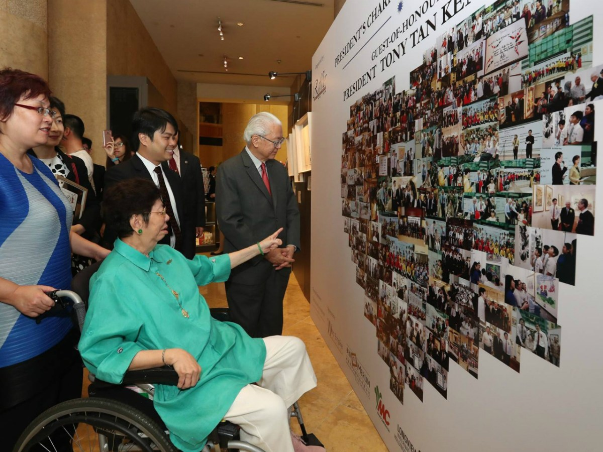 Lim Sew Yong (in green) and Timothy Chionh (third from left) attend the exhibition opening. Photo: Facebook/Dr Tony Tan
