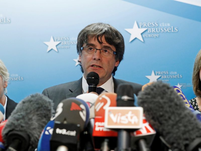 Sacked Catalan leader Carles Puigdemont and former members of the Government of Catalonia Clara Ponsati and Meritxell Borras attend a news conference in Brussels. Photo: Reuters/Yves Herman