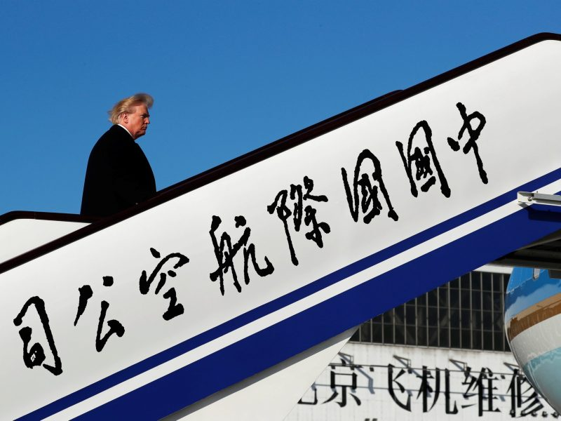 U.S. President Donald Trump boards Air Force One to depart for Vietnam from Beijing Airport in Beijing, China. Photo: Reuters/Jonathan Ernst