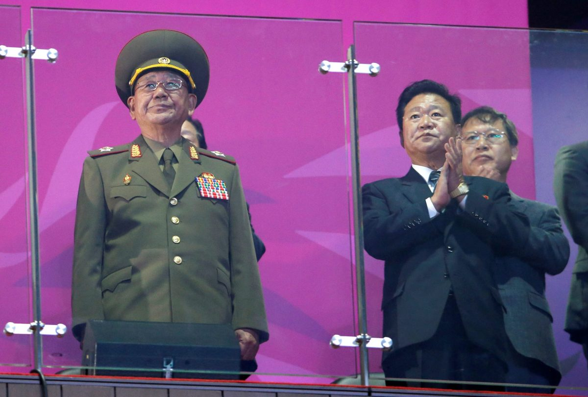 North Korea's Hwang Pyong So (L), a senior aide to North Korea's leader Kim Jong Un, attends the closing ceremony of the 17th Asian Games at the Incheon Asiad Main Stadium, October 4, 2014. Reuters/Jason Reed/File Photo