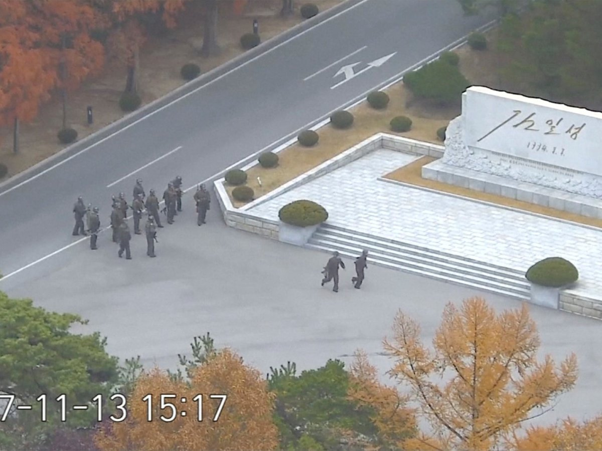 North Korean soldiers hold rifles and gather in the North Korean side of the Joint Security Area at the Demilitarized Zone between North and South Korea, in this still image taken from a video released by the United Nations Command (UNC) on November 22, 2017. United Nations Command/Handout via REUTERS