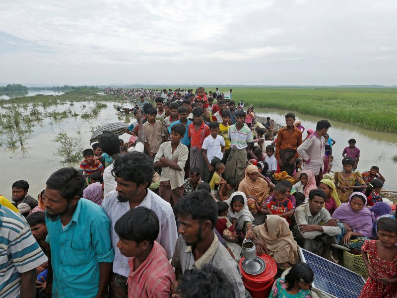 Rohingya refugees wait to be taken to a refugee camp after crossing Naf river at the Bangladesh-Myanmar border in Palong Khali, near Cox's Bazar, Bangladesh on November 2, 2017. Photo: /Adnan Abidi