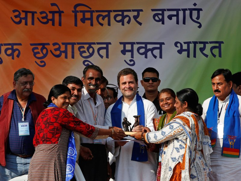 Rahul Gandhi, vice-president of India's main opposition Congress party, receives a memento from people belonging to India's low-caste Dalit community during a rally ahead of Gujarat state assembly elections, at a village on the outskirts of Ahmedabad on November 24, 2017. Photo: Reuters / Amit Dave
