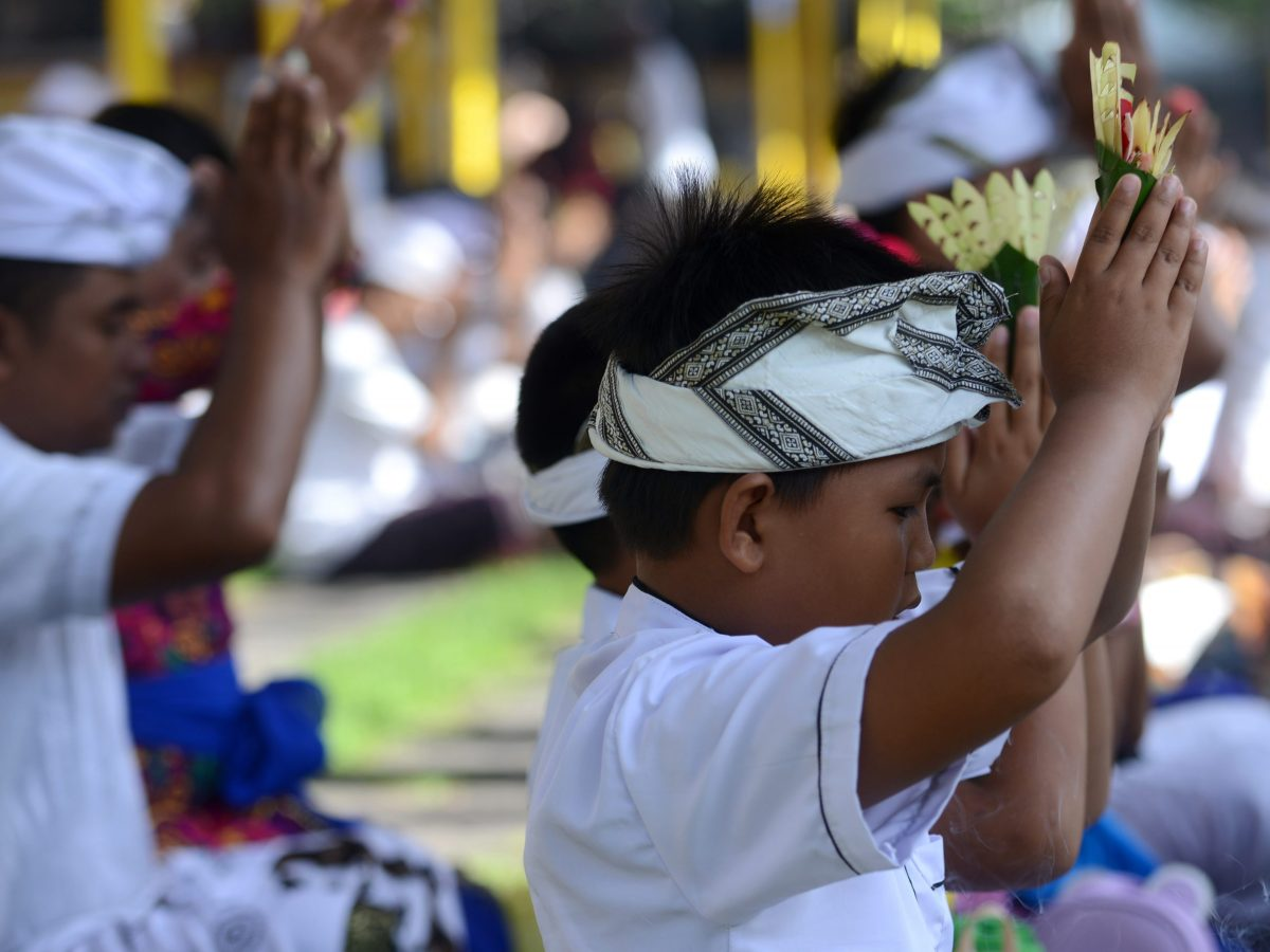 Balinese Hindus pray to celebrate the religious festival Galungan at the Jagat Natha temple in Denpasar on Indonesia's Bali island on November 1, 2017. Balinese Hindu adherents celebrate Galungan Day or the Earth's celebration to thank God for the creation of the Earth and its content. Photo: AFP/Sonny Tumbelaka
