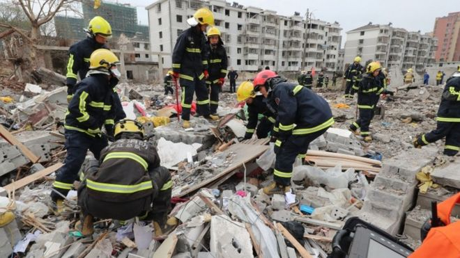 Rescue workers lift debris after the blast in Ningbo on Sunday morning. Photo: AFP