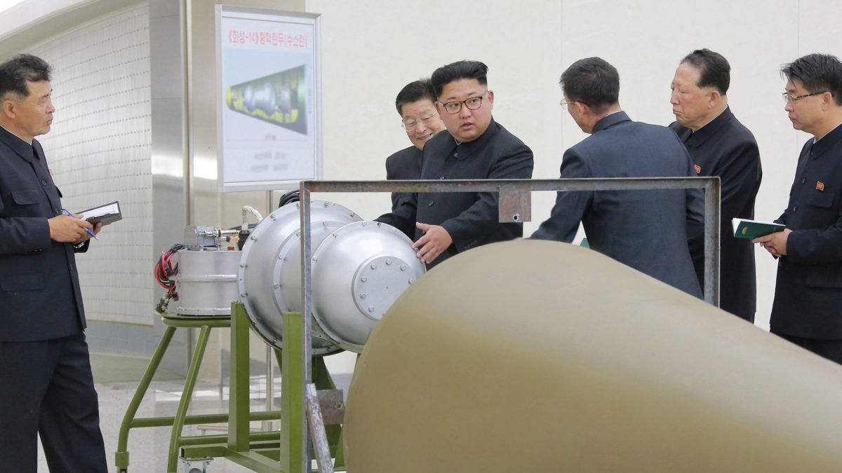 Kim Jong-un inspects a hydrogen bomb model hours before a nuclear test that caused an earthquake on September 3. Photo: KCNA via Reuters