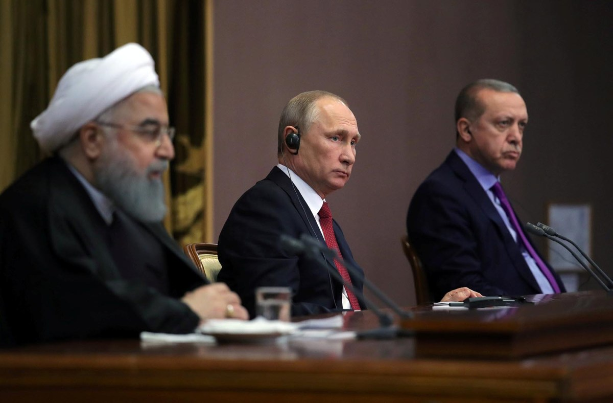 Iran's President Hassan Rouhani, Russia's Vladimir Putin and Turkey's Recep Erdogan, attend a joint news conference following a meeting in Sochi, Russia, on November 22, 2017. Photo: Sputnik / Mikhail Klimentyev via Reuters