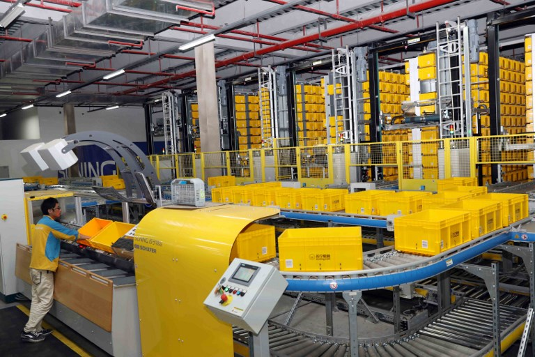 View of the automatic distribution center in the largest smart logistics base in Asia, named Suning Yuncang (Cloud Warehouse) of Chinese e-commerce retailer Suning Group, in Nanjing. Photo: AFP