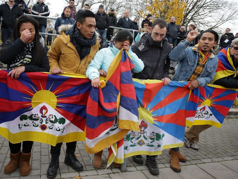 Spectators raise Tibetan flags at the match between TSV Schott Mainz and China's under-20 team at in Mainz-Mombach, Germany, on November 18, 2017. Photo: Hasan Bratic / dpa