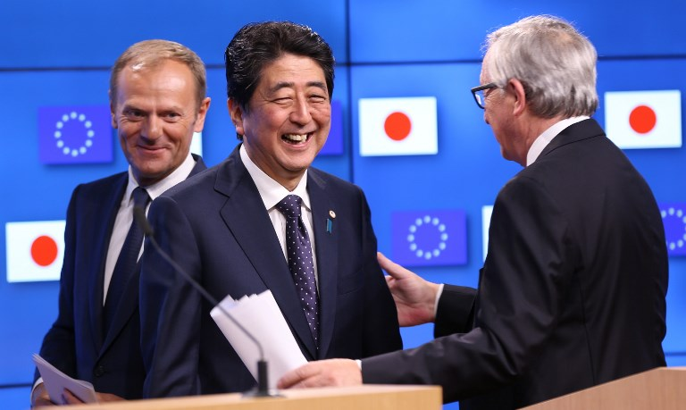European Council President Donald Tusk (L), Japanese Prime Minister Shinzo Abe and European Commission President Jean-Claude Juncker hold a joint press conference after the EU - Japan Summit in Brussels last July. Photo: Anadolu Agency / Dursun Aydemir
