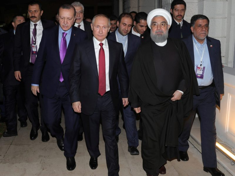 Russia's President Vladimir Putin walks with his counterparts Tayyip Erdogan of Turkey, and Hassan Rouhani of Iran after a joint news conference in Sochi, Russia, on November 22, 2017. Photo: Sputnik / Mikhail Klimentyev / Kremlin via Reuters