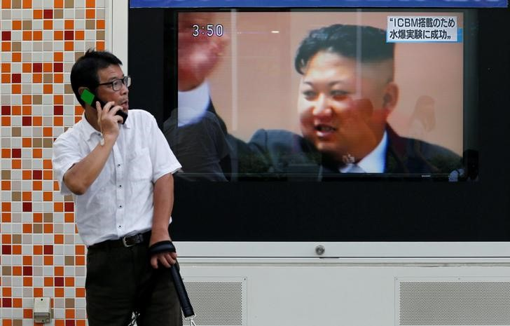 A man walks past a street monitor showing North Korea's leader Kim Jong-Un in a news report about North Korea's nuclear test, in Tokyo, Japan, on Photo: Reuters / Toru Hanai