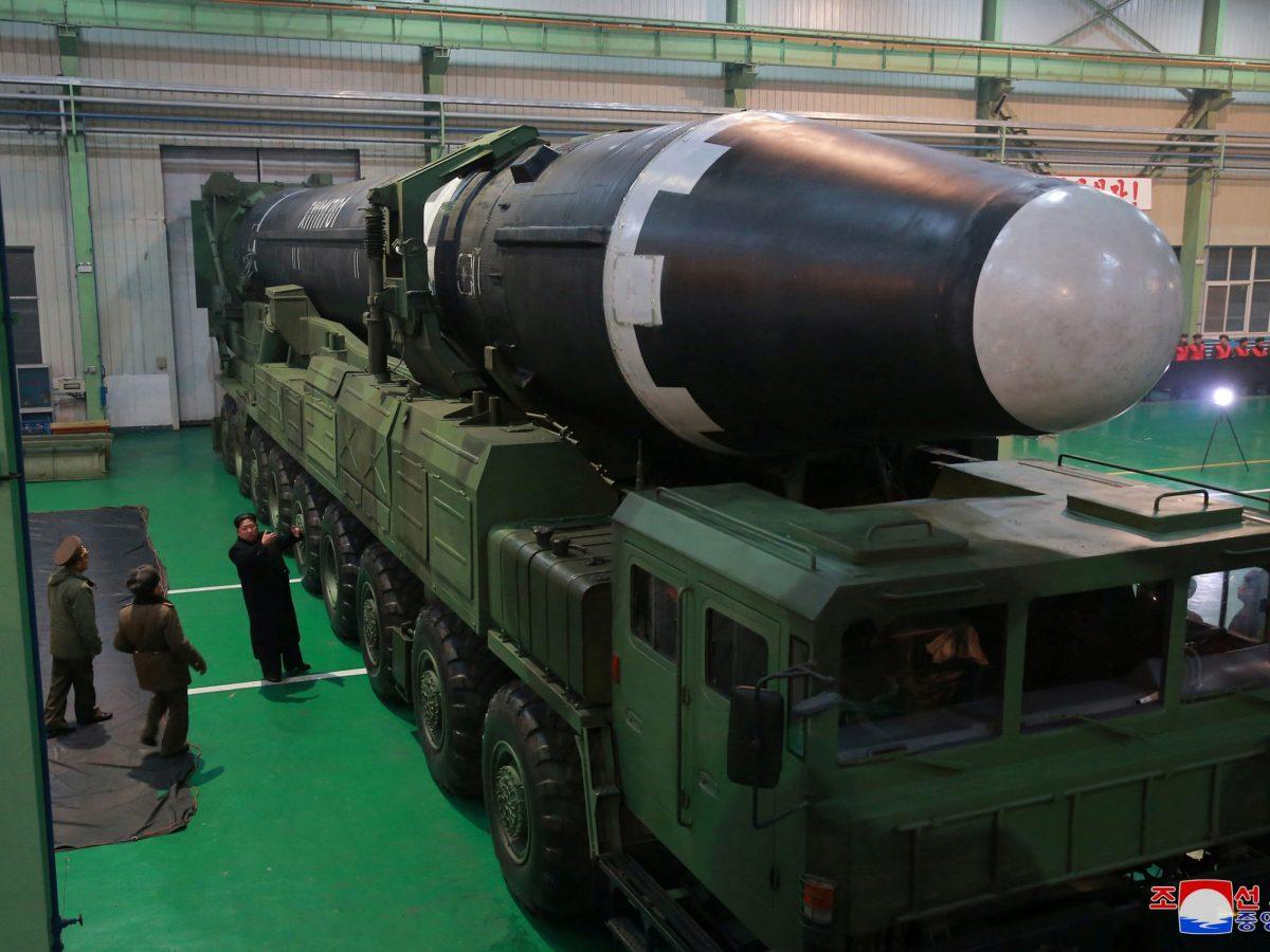 North Korea's leader Kim Jong-un is seen alongside the newly developed intercontinental ballistic rocket Hwasong-15. Photo: Reuters via KCNA