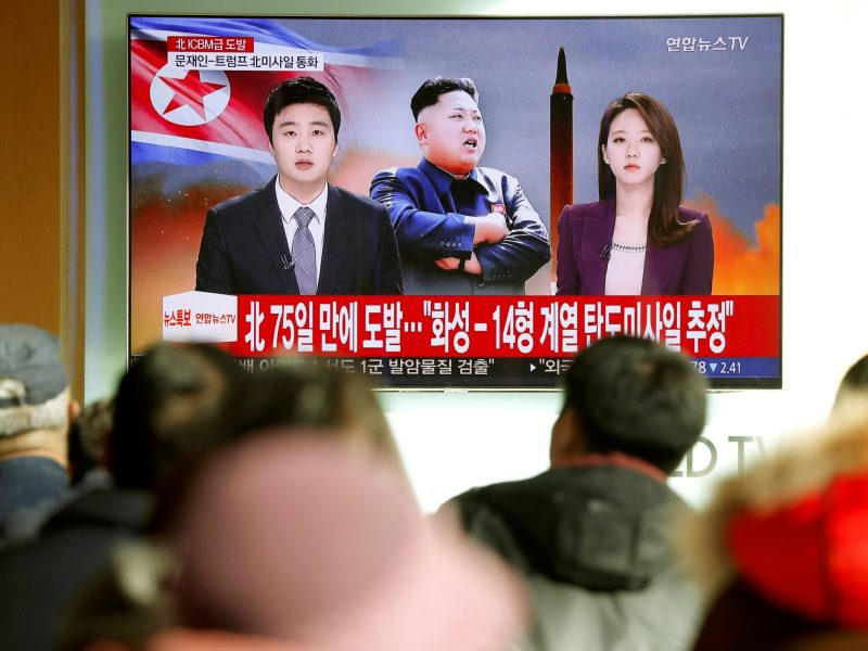 People watch a TV broadcasting a news report on North Korea firing what appeared to be an intercontinental ballistic missile (ICBM) that landed close to Japan, in Seoul, South Korea. Photo: Reuters / Kim Hong-Ji