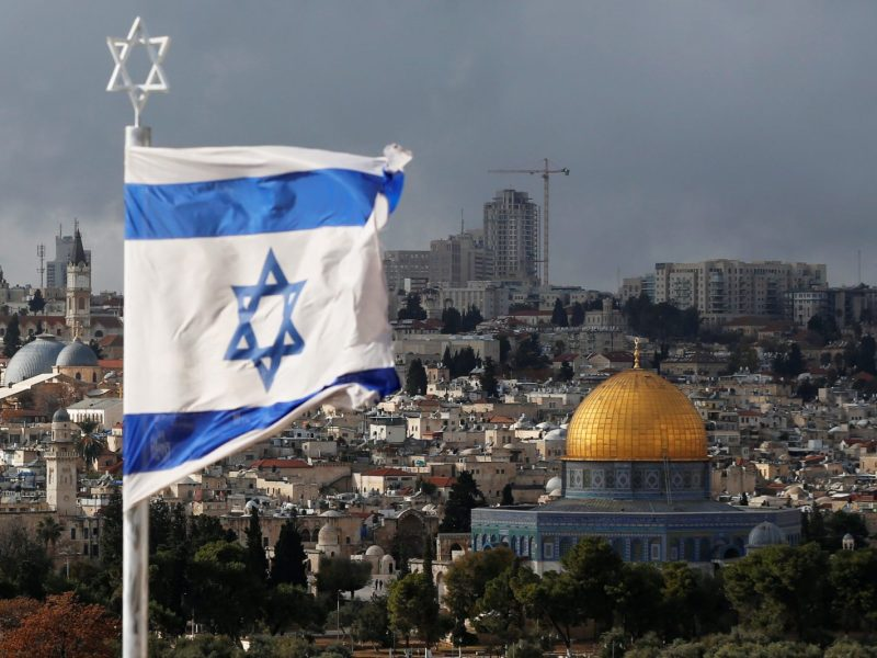 An Israeli flag is seen near the Dome of the Rock, in Jerusalem's Old City on the compound known to Muslims as Noble Sanctuary and to Jews as the Temple Mount, on December 6, 2017. Photo: Reuters / Ammar Awad