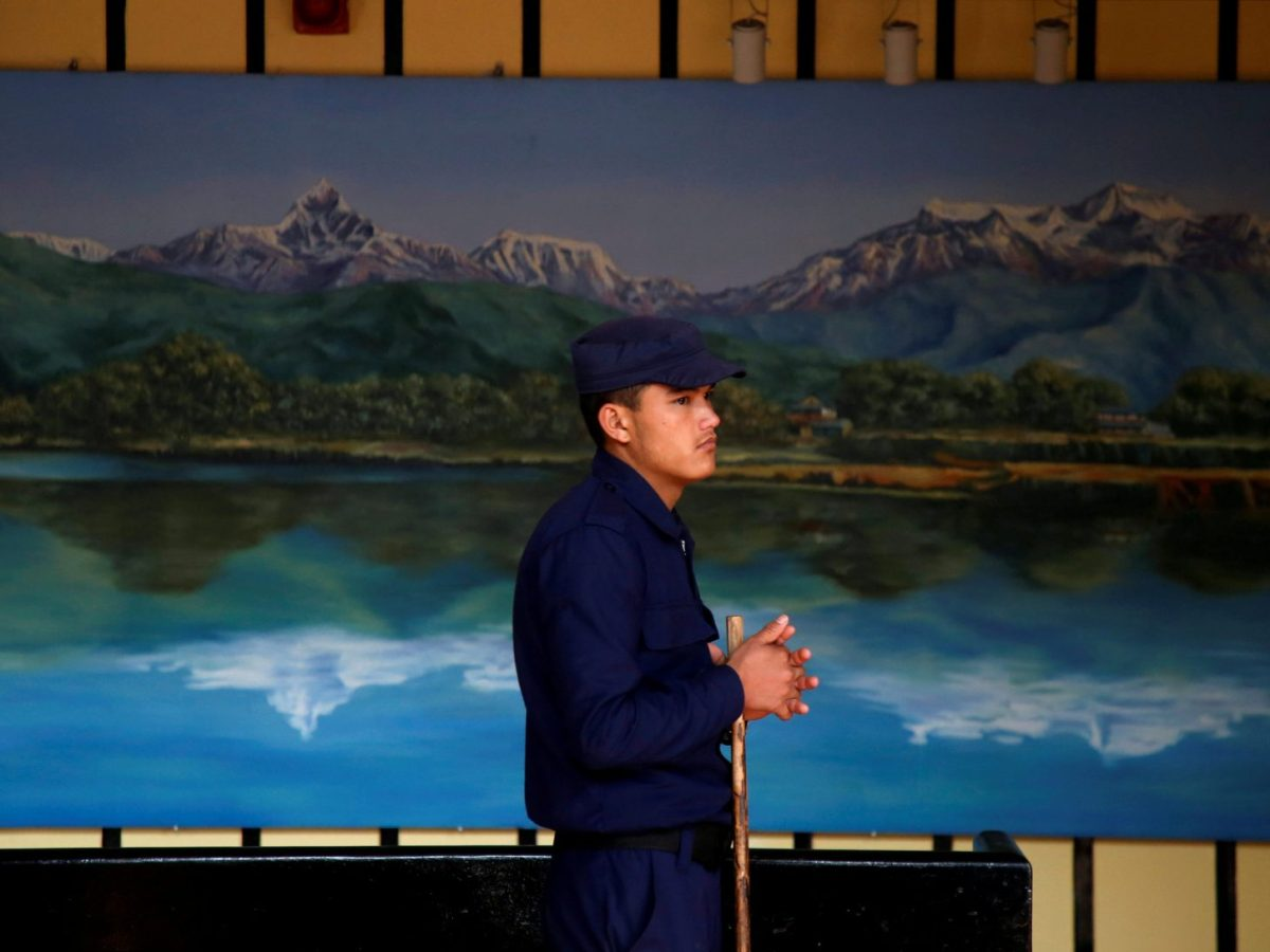 A police officer stands guard as officials start counting votes in Kathmandu's city hall a day after parliamentary and provincial elections in Nepal. December 8, 2017. Photo: Reuters / Navesh Chitrakar