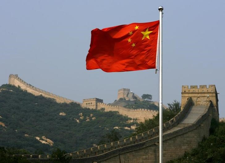 A Chinese flag flies in front of the Great Wall of China, located north of Beijing August 18, 2007. Photo:       Reuters/David Gray