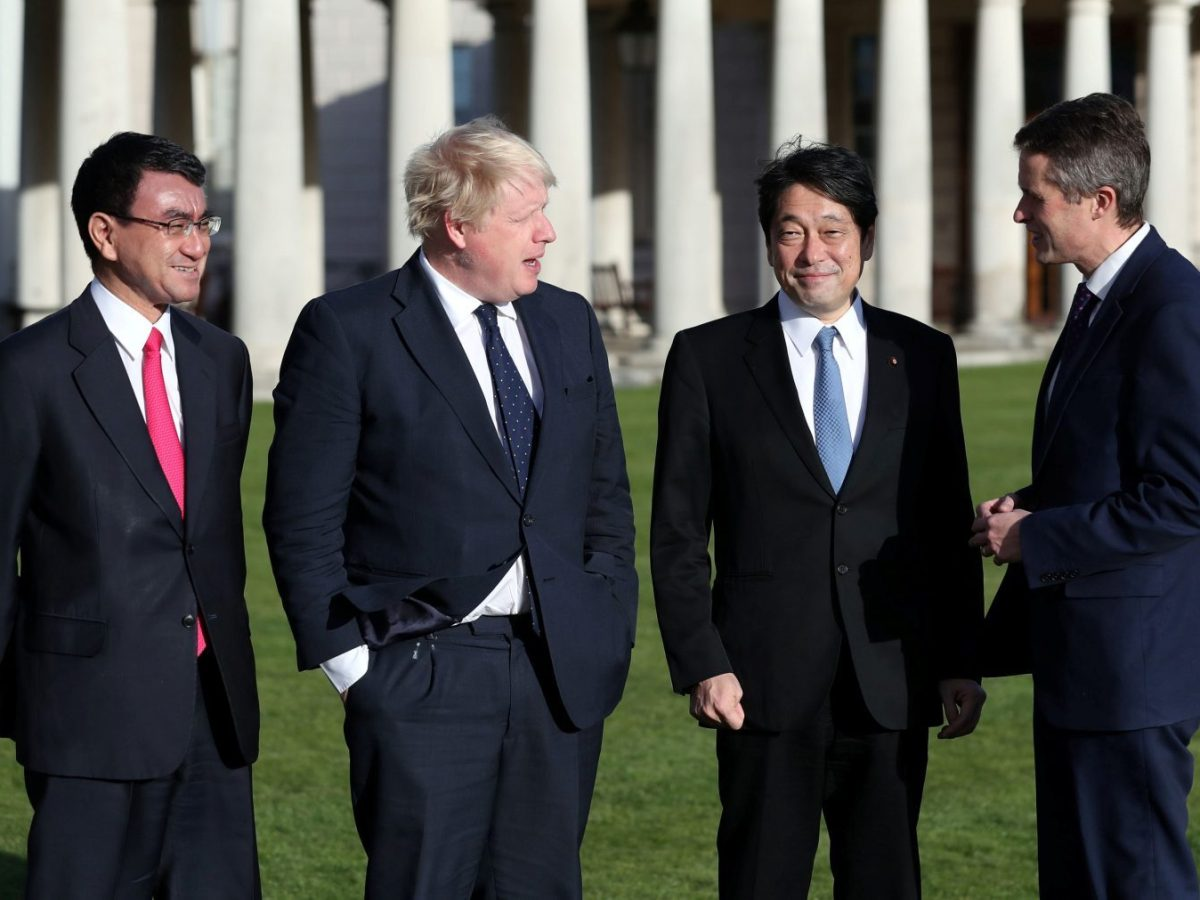 Britain's Foreign Secretary Boris Johnson and Defence Secretary Gavin Williamson welcome Japan's Defence Minister Itsunori Onodera and Foreign Minister Taro Kono at the National Maritime Museum in London, on December 14, 2017. Photo: Reuters / Andrew Matthews