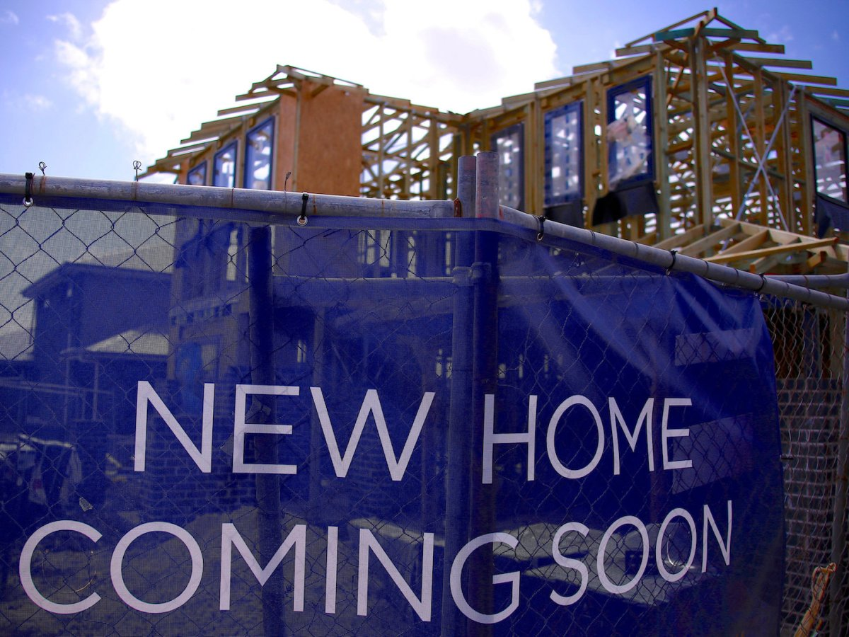 FILE PHOTO: A house under construction can be seen behind an advertising banner at a housing development located in the western Sydney suburb of Oran Park in Australia, October 21, 2017.   REUTERS/David Gray/File Photo