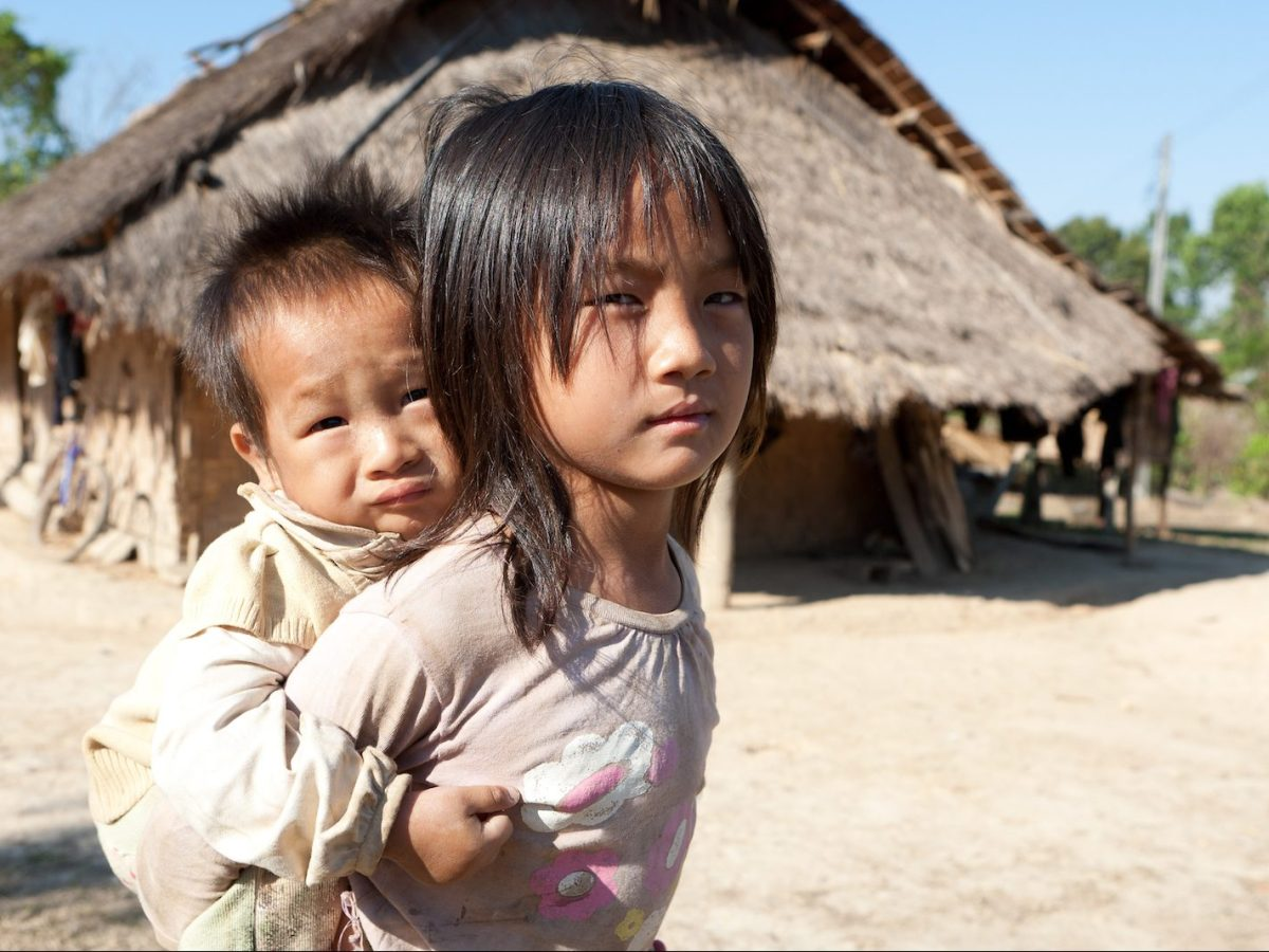 Lao children in a village setting. The Lao government aims to implement a universal health care scheme to cover remote impoverished areas of the country. Photo: iStock/Getty Images