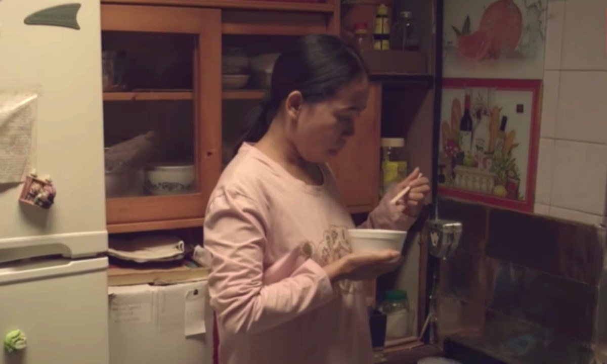 In a TV program produced by RTHK31, Martika, a Filipino domestic worker, prefers to take her meals in the kitchen alone. Photo: RTHK31