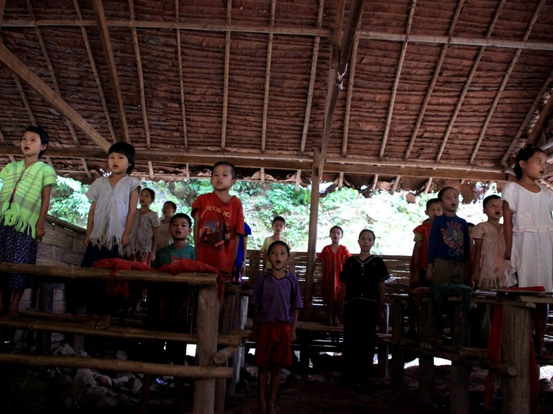 Students in an elementary school at Ei Tu Hta IDP camp on the Thai-Myanmar border sing the Karen national anthem. Children in Ei Tu Hta IDP camp learn their own Karen history and mother tongue to maintain their cultural identity. File Photo: AFP via EPN/Lee Yu Kyung