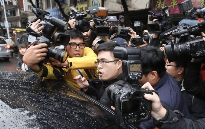 New Party spokesman and pro-Beijing politician Wang Ping-chung is seen in a media scrum prior to his arrest. Photo: Central News Agency