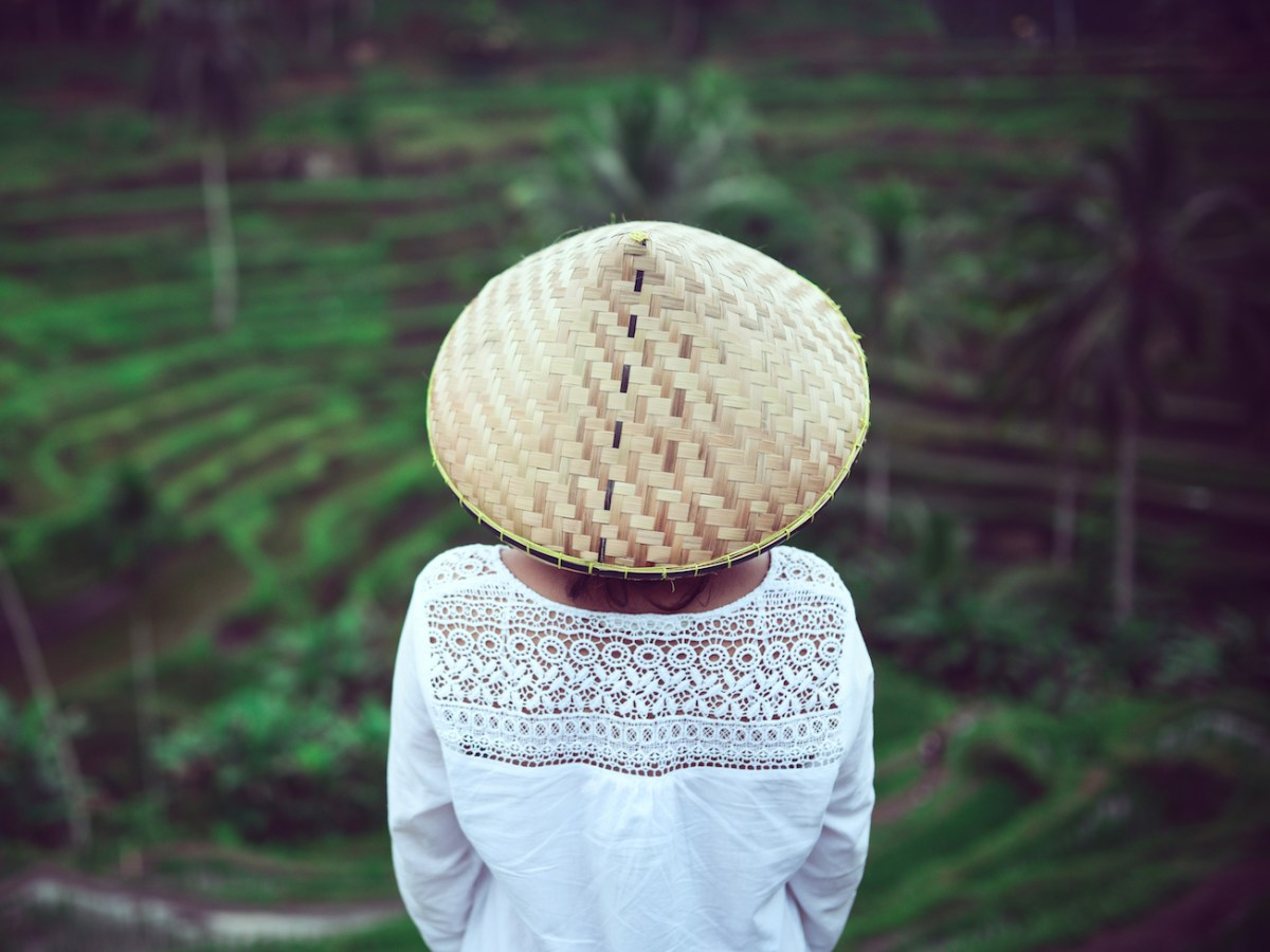 A Vietnamese woman overlooks her fields. Photo: iStock/Getty Images