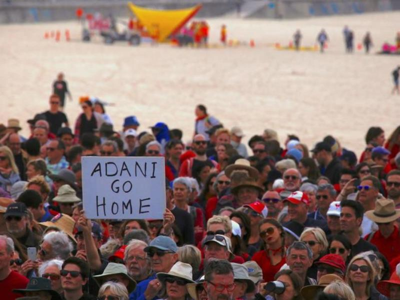 Protesters have rallied around Australia against Adani's giant coal mine project in Queensland. This picture was taken at Sydney's Bondi Beach on October 7, 2017 Photo: Reuters
