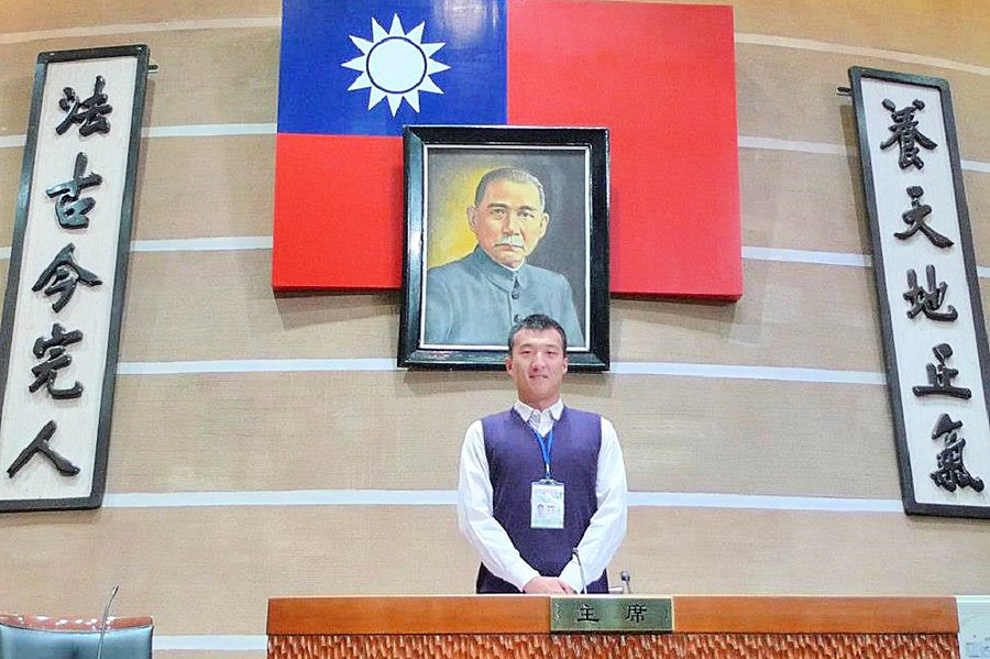 A photo from Zhou Hongxu's Facebook page shows him in front of the Republic of China (Taiwan) flag and a portrait of Sun Yat-sen.