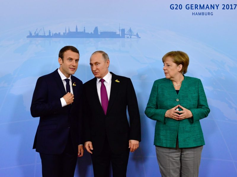 German Chancellor Angela Merkel poses with French President Emmanuel Macron (left) and Russia's President Vladimir Putin (center) during the G20 summit in Hamburg, Germany. Photo: AFP / Tobias Schwarz
