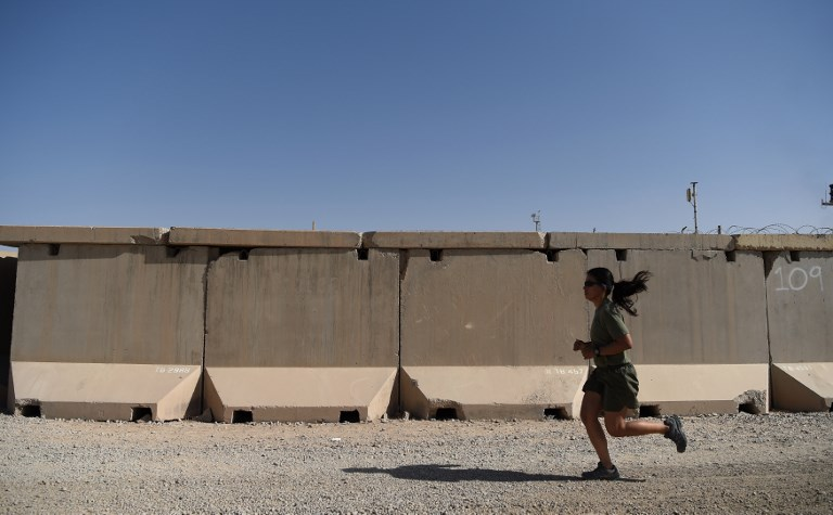 A US Marine exercises at the Shorab Military Camp in Lashkar Gah in the Afghan province of Helmand. Photo: AFP/Wakil Kohsar
