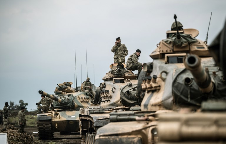 Turkish tanks gather close to the Syrian border on January 21, 2018, at Hassa, in Hatay province. Photo: AFP/Bulent Kilic