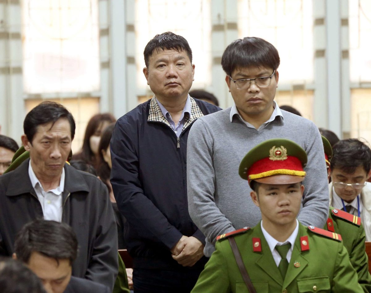 Dinh La Thang (center) listens as the verdict is delivered on his case in Hanoi, Vietnam, on January 22. Photo: VNA / Doan Tan via Reuters