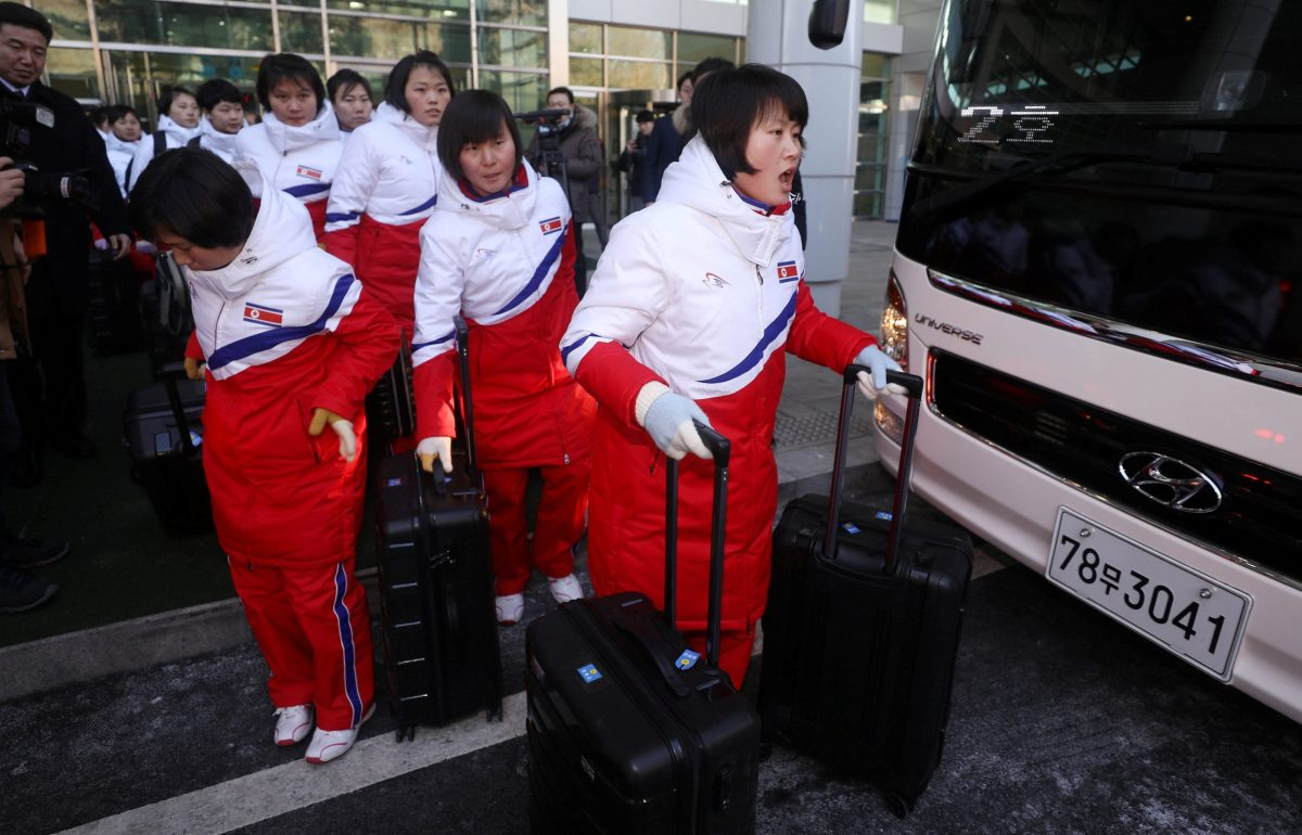 North Korea's women's ice hockey athletes arrive at the South's CIQ (Customs, Immigration and Quarantine), just south of the demilitarized zone in Paju, South Korea, on January 25, 2018. Photo: Korea Pool / Yonhap via Reuters